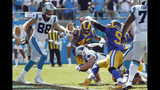 Carolina Panthers running back Christian McCaffrey (22) dives into the end zone as tight end Greg Olsen (88) watches during the second half of an NFL football game against the Los Angeles Rams in Charlotte, N.C., Sunday, Sept. 8, 2019. (AP Photo/Brian Blanco)