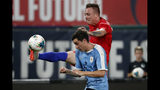 United States' Corey Baird reaches for the ball as Uruguay's Jose Gimenez, front, defends during the second half of a friendly soccer match Tuesday, Sept. 10, 2019, in St. Louis. The game ended in a 1-1 tie. (AP Photo/Jeff Roberson)
