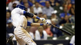 Milwaukee Brewers' Christian Yelich hits a winning RBI-double during the ninth inning of a baseball game against the Chicago Cubs, Saturday, Sept. 7, 2019, in Milwaukee. (AP Photo/Aaron Gash)