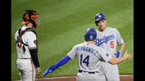 Los Angeles Dodgers' Corey Seager (5) celebrates his two-run home run with Enrique Hernandez (14) during the third inning of a baseball game, next to Baltimore Orioles catcher Chance Sisco on Tuesday, Sept. 10, 2019, in Baltimore. (AP Photo/Nick Wass)
