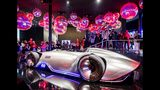 """The Mercedes concept car """"EQ Silver Arrow"""" is surrounded by media people at the IAA Auto Show in Frankfurt, Germany, Monday, Sept. 9, 2019. The IAA starts with two media days on Tuesday and Wednesday. (AP Photo/Michael Probst)"""
