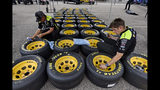 Driver Paul Menard crew members prepare tires before a NASCAR Cup Series auto race Sunday, Sept. 1, 2019, at Darlington Raceway in Darlington, S.C. (AP Photo/Richard Shiro)