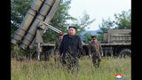 """In this Tuesday, Sept. 10, 2019, photo provided by the North Korean government, North Korean leader Kim Jong Un visits a multiple rocket launcher site at an undisclosed location in North Korea. The content of this image is as provided and cannot be independently verified. Korean language watermark on image as provided by source reads: """"KCNA"""" which is the abbreviation for Korean Central News Agency. (Korean Central News Agency/Korea News Service via AP)"""