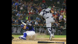 Texas Rangers Shin-Soo Choo slides home to score on a double by Willie Calhoun ahead of the throw to Tampa Bay Rays catcher Michael Perez during the fourth inning of a baseball game Tuesday, Sept. 10, 2019, in Arlington, Texas. (AP Photo/Richard W. Rodriguez)