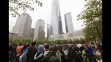 FILE- In this May 15, 2015 file photo, visitors gather near the pools at the 9/11 Memorial in New York. As they have done 17 times before, a crowd of victims' relatives is expected at the site on Wednesday, Sept. 11, 2019 to observe the anniversary the deadliest terror attack on American soil. (AP Photo/Frank Franklin II)