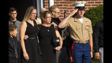 Kiersten Haub, from left, Erika Starke, and Michael Haub, family members of New York firefighter Michael Haub, attend a second funeral service for him in Franklin Square, N.Y., Tuesday, Sept. 10, 2019. The firefighter from New York's Long Island who died in the World Trade Center attacks is being remembered for a second time on the eve of the 18th anniversary of 9/11. Friends and family gathered at the memorial service for Haub on Tuesday in Franklin Square. Last week, the New York City medical examiner identified more of his remains recovered at ground zero. (AP Photo/Eduardo Munoz Alvarez)