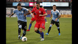 Uruguay's Martin Caceres (22) and United States' Sebastian Lletget (17) chase after a loose ball as Uruguay's Brian Lozano (7) watches during the second half of a friendly soccer match Tuesday, Sept. 10, 2019, in St. Louis. The game ended in a 1-1 tie. (AP Photo/Jeff Roberson)