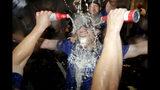 Los Angeles Dodgers hitting strategist Brant Brown is doused during a lockerroom celebration after the Dodgers defeated the Baltimore Orioles 7-3 in a baseball game Tuesday, Sept. 10, 2019, in Baltimore. The Dodgers clinched the NL West title. (AP Photo/Julio Cortez)