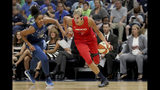 FILE - In this Aug. 16, 2019, file photo, Washington Mystics' Elena Delle Donne drives against Minnesota Lynx's Damiris Dantas (92) during a WNBA basketball game in Minneapolis. Delle Donne was named the Associated Press WNBA Player of the Year, Wednesday, Sept. 11, 2019. (David Joles/Star Tribune via AP, File)