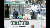 """FBI agents search the Truth dive boat, a sister vessel to the Conception, as authorities issue a search warrant for the Truth Aquatics' offices on the Santa Barbara Harbor in Santa Barbara, Calif., Sunday, Sept. 8, 2019. The office was ringed in red """"crime scene"""" tape as more than a dozen agents took photos and carried out boxes. Thirty-four people died when the Conception burned and sank before dawn on Sept. 2. They were sleeping in a cramped bunkroom below the main deck and their escape routes were blocked by fire. (AP Photo/Christian Monterrosa)"""