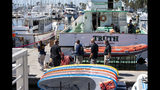 Authorities walk outside the Truth, a Truth Aquatics-owned dive boat, docked in the Santa Barbara Harbor in Santa Barbara, Calif., Sunday, Sept. 8, 2019. Authorities served search warrants Sunday at the Southern California company that owned the scuba diving boat that caught fire and killed 34 people last week. (AP Photo/ Christian Monterrosa)