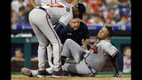 Atlanta Braves' Johan Camargo reacts after an injury during the fourth inning of the team's baseball game against the Philadelphia Phillies, Wednesday, Sept. 11, 2019, in Philadelphia. (AP Photo/Matt Slocum)
