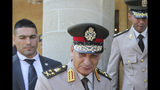 Egyptian counterpart Lt. Gen. Mohamed Ahmed Zak leaves the presidential palace after a meeting with Cyprus' defense minister Savvas Angelides and Cypriot president Nicos Anastasiades at presidential palace in Nicosia, Cyprus, Wednesday, Sept. 11, 2019. Cyprus' defense minister says the east Mediterranean island nation and neighbor Egypt are exchanging information to bolster security around an offshore search for natural gas as part of enhanced defense ties. (AP Photo/Petros Karadjias)