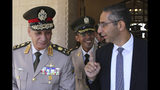 Cyprus' defense minister Savvas Angelides, right, talks with his Egyptian counterpart Lt. Gen. Mohamed Ahmed Zak, left, after a meeting with Cypriot president Nicos Anastasiades at presidential palace in Nicosia, Cyprus, Wednesday, Sept. 11, 2019. Cyprus' defense minister says the east Mediterranean island nation and neighbor Egypt are exchanging information to bolster security around an offshore search for natural gas as part of enhanced defense ties. (AP Photo/Petros Karadjias)