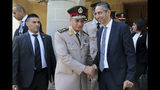 Cyprus' defense minister Savvas Angelides, right, shakes hands with his Egyptian counterpart Lt. Gen. Mohamed Ahmed Zak, left, after a meeting with Cypriot president Nicos Anastasiades at presidential palace in Nicosia, Cyprus, Wednesday, Sept. 11, 2019. Cyprus' defense minister says the east Mediterranean island nation and neighbor Egypt are exchanging information to bolster security around an offshore search for natural gas as part of enhanced defense ties. (AP Photo/Petros Karadjias)