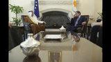 Cyprus' president Nicos Anastasiades, right, and Saudi Foreign Minister Ibrahim Bin Abdulaziz Al-Assaf talk during their meeting at the presidential palace in capital Nicosia, Cyprus, Wednesday Sept. 11, 2019. Al-Assaf is in Cyprus for talks. (AP Photo/Petros Karadjias)