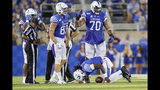 Kentucky quarterback Terry Wilson (3) knees and grabs his left knee after being injured on a play during the second half of an NCAA college football game against Eastern Michigan, Saturday, Sept. 7, 2019, in Lexington, Ky. (AP Photo/Bryan Woolston)