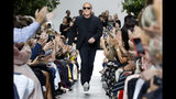 Designer Michael Kors is applauded on the runway after his collection was modeled during Fashion Week in New York, Wednesday, Sept. 11, 2019. (AP Photo/Richard Drew)