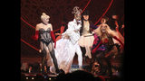 "This Sept. 9, 2019 photo shows actor-singer Billy Porter, center, performing at the ""The Blonds x Moulin Rouge!"" show during Fashion Week in New York. (AP Photo/Ragan Clark)"