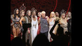 "This Sept. 9, 2019 photo shows, foreground from third left, Jordan Roth, Billy Porter, The Blonds designers David Blond and Phillipe Blond and Paris Hilton, second right, after the ""The Blonds x Moulin Rouge!"" show during Fashion Week in New York. (AP Photo/Ragan Clark)"
