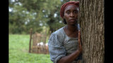 """This image released by Focus Features shows Cynthia Erivo as Harriet Tubman in a scene from """"Harriet,"""" a film that will be featured during the Toronto Film Festival. (Glen Wilson/Focus Features via AP)"""