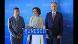 Governor of the province Nineveh Mansour al-Mareed, left, UNESCO'S Director-General Audrey Azoulay , center, and Iraq's Culture Minister Abdulamir al-Dafar Hamdani attend a media conference at the UNESCO's headquarters in Paris, Wednesday, Sept. 11. 2019. Iraqi officials meet at the UN's cultural agency in Paris to discuss plans for an ambitious $100 million reconstruction of the Islamic State-ravaged city of Mosul. (AP Photo/Michel Euler)