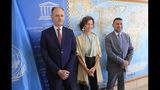Iraq's Culture Minister Abdulamir al-Dafar Hamdani, left, and Governor of the province Nineveh Mansour al-Mareed, right, are welcomed by UNESCO'S Director-General Audrey Azoulay at the UNESCO's headquarters in Paris, Wednesday, Sept. 11. 2019. Iraqi officials meet at the UN's cultural agency in Paris to discuss plans for an ambitious $100 million reconstruction of the Islamic State-ravaged city of Mosul. (AP Photo/Michel Euler)