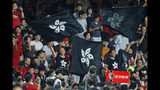 "Hong Kong soccer fans wave black version of the Hong Kong flags to protest against government during the FIFA World Cup Qatar 2022 and AFC Asian Cup 2023 Preliminary Joint Qualification Round 2 soccer match between Hong Kong and Iran, in Hong Kong, Tuesday, Sept. 10, 2019. The crowd broke out into ""Glory to Hong Kong,"" a song reflecting their campaign for more democratic freedoms in the semi-autonomous Chinese territory. (AP Photo/Kin Cheung)"