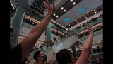 "Local residents sing a theme song written by protesters ""Glory be to thee"" at a shopping mall in Hong Kong Wednesday, Sept. 11, 2019. Hong Kong Chief Executive Carrie Lam reassured foreign investors Wednesday that the Asian financial hub can rebound from months of protests, despite no sign that the unrest will subside. (AP Photo/Vincent Yu)"