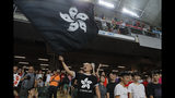 """Hong Kong soccer fans waves a black version of the Hong Kong flag to protest against government during the FIFA World Cup Qatar 2022 and AFC Asian Cup 2023 Preliminary Joint Qualification Round 2 soccer match between Hong Kong and Iran, in Hong Kong, Tuesday, Sept. 10, 2019. The crowd broke out into """"Glory to Hong Kong,"""" a song reflecting their campaign for more democratic freedoms in the semi-autonomous Chinese territory. (AP Photo/Kin Cheung)"""
