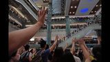"""Protesters gesture as they sing a theme song written by protesters """"Glory be to thee"""" at a shopping mall in Hong Kong Wednesday, Sept. 11, 2019. Hundreds of Hong Kong citizens gathered at several malls late Wednesday, chanting slogans and belting out a new protest song. The song, """"glory to Hong Kong"""", was penned online and has been embraced by protesters as their anthem song. The peaceful mall gatherings marked a respite after violent clashes over the weekend. (AP Photo/Vincent Yu)"""