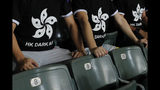"""Hong Kong soccer fans wear T-shirt featuring black version of the Hong Kong flags to protest against government during the FIFA World Cup Qatar 2022 and AFC Asian Cup 2023 Preliminary Joint Qualification Round 2 soccer match between Hong Kong and Iran, in Hong Kong, Tuesday, Sept. 10, 2019. The crowd broke out into """"Glory to Hong Kong,"""" a song reflecting their campaign for more democratic freedoms in the semi-autonomous Chinese territory. (AP Photo/Kin Cheung)"""