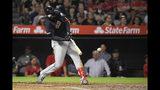 El jugador de los Indios de Cleveland Franmil Reyes pega un doble de tres carreras en el tercer inning de su juego de béisbol contra los Angelinos de Los Ángeles, el martes 10 de septiembre de 2019, en Anaheim, California. (AP Foto/Mark J. Terrill)