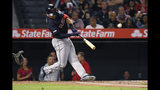 Cleveland Indians' Jordan Luplow hits a two-run home run during the second inning of a baseball game against the Los Angeles Angels on Tuesday, Sept. 10, 2019, in Anaheim, Calif. (AP Photo/Mark J. Terrill)