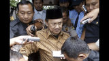 FILE - In this March 27, 2007, file photo, former Indonesian President B.J. Habibie, center, is surrounded by journalists after a hearing in Jakarta, Indonesia. Habibie, who allowed democratic reforms and an independence referendum for East Timor following the ouster of the dictator Suharto, has died at age 83. (AP Photo/Achmad Ibrahim, File)
