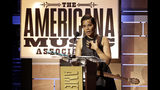 Rhiannon Giddens accepts the Legacy of Americana Award at the Americana Honors & Awards show Wednesday, Sept. 11, 2019, in Nashville, Tenn. (AP Photo/Wade Payne)