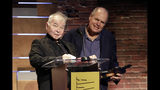"""John Prine, left, and Pat McLaughlin accept the Song of the Year Award for """"Summer's End"""" at the Americana Honors & Awards show Wednesday, Sept. 11, 2019, in Nashville, Tenn. (AP Photo/Wade Payne)"""