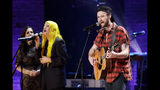 Ruston Kelly, right, performs during the Americana Honors & Awards show Wednesday, Sept. 11, 2019, in Nashville, Tenn. (AP Photo/Wade Payne)