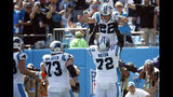 Carolina Panthers offensive tackle Taylor Moton (72) lifts running back Christian McCaffrey (22) following McCaffrey's touchdown against the Los Angeles Rams during the second half of an NFL football game in Charlotte, N.C., Sunday, Sept. 8, 2019. (AP Photo/Brian Blanco)