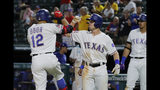 Texas Rangers' Rougned Odor (12) and Nick Solak celebrate Odor's three-run home run as Ronald Guzman, right rear, watches during the seventh inning of the team's baseball game against the Tampa Bay Rays in Arlington, Texas, Wednesday, Sept. 11, 2019. (AP Photo/Tony Gutierrez)