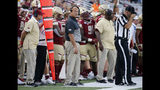 Boston College head coach Steve Addazio, center, looks on from the sideline during the second half of an NCAA college football game against Richmond, Saturday, Sept. 7, 2019, in Boston. (AP Photo/Mary Schwalm)