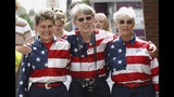 """FILE - In this Sept. 10, 2004, file photo, The """"Freeport Flag Ladies"""" leave a campaign rally for President Bush in Lewiston, Maine. From left are Carmen Footer, Elaine Greene and JoAnn Miller, all of Freeport, Maine. The three women who've been waving the Stars and Stripes each week since the 9/11 attacks are folding up their flags in Freeport, Maine. The tradition started after the terrorist attacks 18 year ago. (AP Photo/Robert F. Bukaty, File)"""
