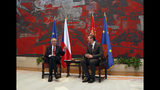 Czech Republic's president Milos Zeman, left, speaks with his Serbian counterpart Aleksandar Vucic at the Serbia Palace in Belgrade, Serbia, Wednesday, Sept. 11, 2019. Zeman is on a two-day official visit to Serbia. (AP Photo/Darko Vojinovic)