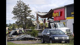 The aftermath of tornado damage to Advance Auto Parts on 41st Ave, is seen, Wednesday, Sept. 11, 2019, in Sioux Falls, S.D. A storm carrying three tornadoes struck South Dakota's largest city overnight, leaving a trail of destroyed buildings and downing power lines. (Erin Bormett/The Argus Leader via AP)