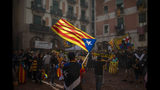 "Protesters hold independence flags during the Catalan National Day in Barcelona, Spain, Wednesday, Sept. 11, 2019. The traditional September 11, called ""Diada"", marks the fall of the Catalan capital to Spanish forces in 1714. (AP Photo/Emilio Morenatti)"