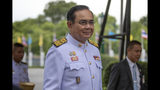 FILE - In this Aug. 27, 2019, file photo, Thailand's Prime Minister Prayuth Chan-ocha walks to a cabinet meeting at the Government House of Thailand in Bangkok, Thailand. Prayuth omitted a sentence in the oath of office when he led his Cabinet in the oath in front of King Maha Vajiralongkorn on July 16, and Thailand's ombudsman ruled Tuesday that it will refer the matter to the Constitutional Court to decide whether the government was legally installed. (AP Photo/Gemunu Amarasinghe, File)