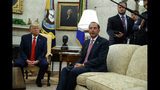 President Donald Trump listens as Secretary of Health and Human Services Alex Azar talks about a plan to ban most flavored e-cigarettes, in the Oval Office of the White House, Wednesday, Sept. 11, 2019, in Washington. (AP Photo/Evan Vucci)
