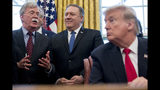 """FILE - In this Feb. 7, 2019 file photo, from left, National Security Adviser John Bolton, accompanied by Secretary of State Mike Pompeo, and President Donald Trump, speaks before Trump signs a National Security Presidential Memorandum to launch the """"Women's Global Development and Prosperity"""" Initiative in the Oval Office of the White House in Washington. Trump has fired national security adviser John Bolton. Trump tweeted Tuesday that he told Bolton Monday night that his services were no longer needed at the White House. (AP Photo/Andrew Harnik)"""