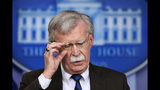 FILE - In this Nov. 27, 2018 file photo, National security adviser John Bolton speaks to reporters during the daily press briefing in the Brady press briefing room at the White House in Washington. Trump says he fired national security adviser John Bolton, says they 'disagreed strongly' on many issues. (AP Photo/Manuel Balce Ceneta)