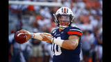 Auburn quarterback Bo Nix warms up for the team's NCAA college football game again Tulane, Saturday, Sept. 7, 2019, in Auburn, Ala. (AP Photo/Butch Dill)